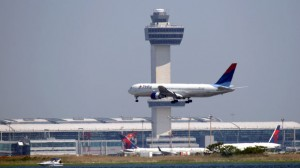 JFK Airport control tower with Delta 767