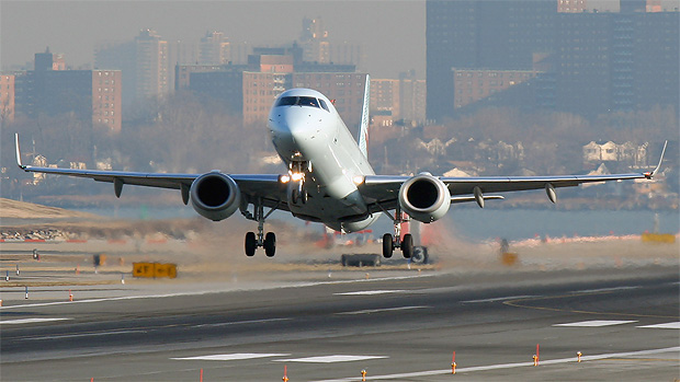 An Air Canada E190 lifts off from LGA's Rwy 4 on a cold January morning.