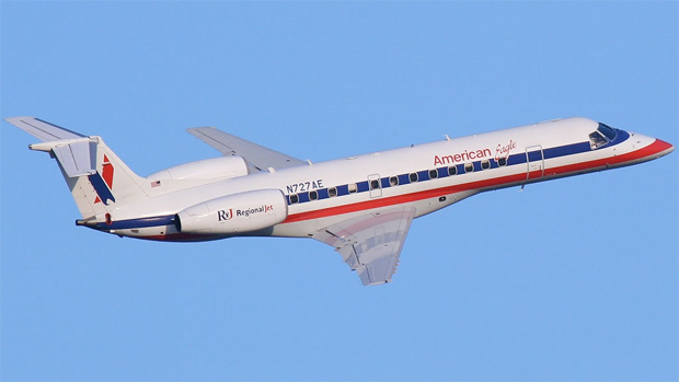American Eagle N727AE banking right after lift off from Rwy 13 at LaGuardia.
