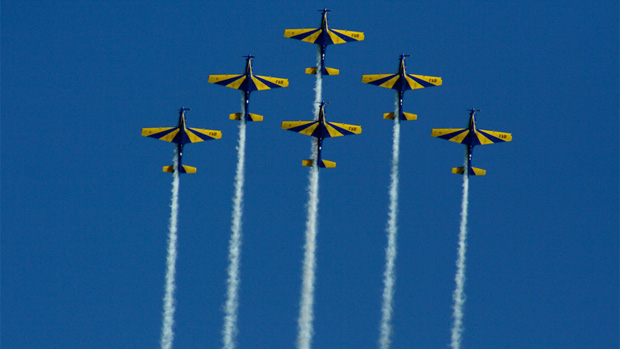 "The Brazilian Military Acrobatic Team ""Smoke Squadron"" using Embraer T-27s, performs at Curitiba, Brasil."