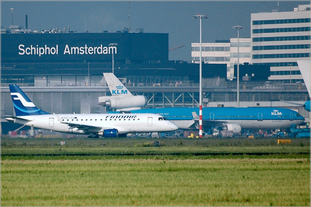 A Finnair E-170 passes some much larger traffic in the background at AMS. Photo by caribb