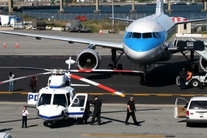 A US Airways A319 and PAPD Sikorsky-76 are seen during Kids Day preparation in 2007.