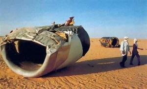 An engine from UTA Flight 772 sits in the desert after a bomb exploded in its cargo hold.