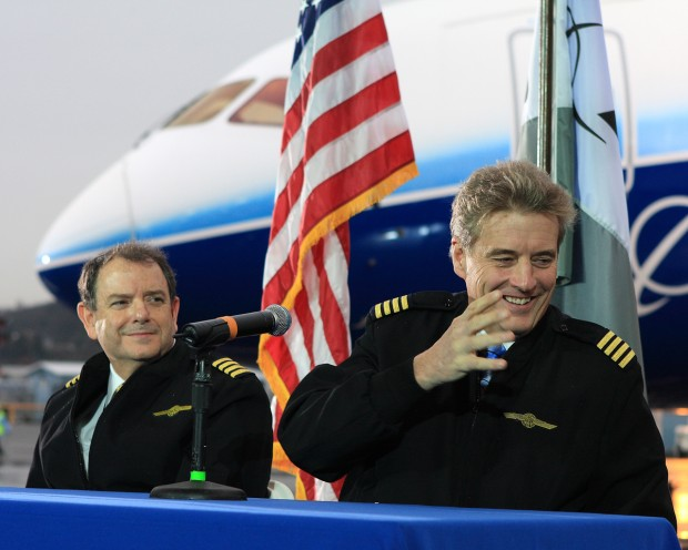 Pilots of the first 787 flight, Capt. Mike Carriker, right, and Randy Neville, left, speak to the media after landing in Seattle.