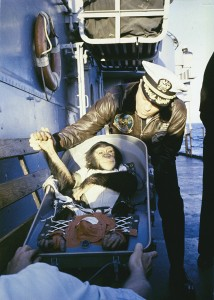 Ham the Chimp shakes hands in his car-seat with recovery ship USS Donner's commander after his sub-orbit flight.
