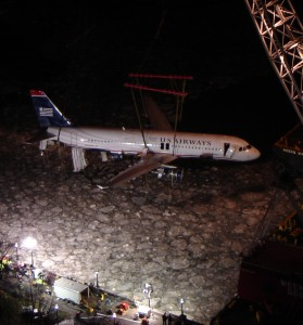 N106US being hoisted out of the Hudson after a chilly bath from the water ditching of US Airways Flight 1549.