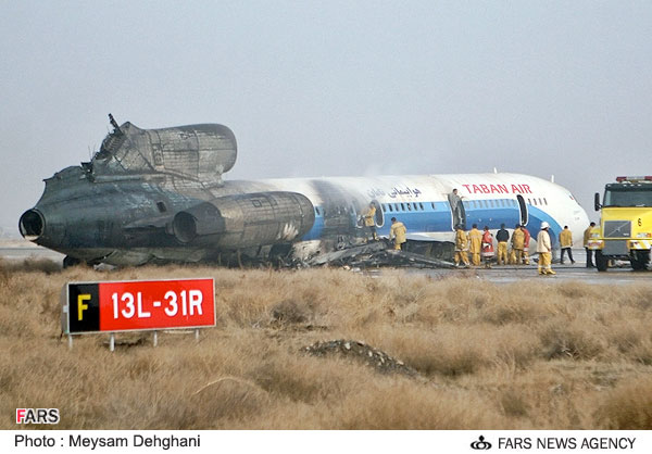 The wreckage of a Taban Air Tu-154, reg RA-85787, at Mashhad International Airport.
