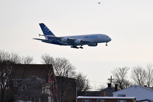 Coming in low over the houses in the towns surroudning Boston. (Photo by Matt Tomlin)