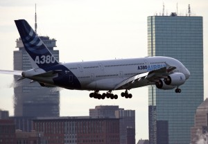 The Airbus A380 passes the Prudential Building in Boston while apporaching rwy 33L. (Photo by Mark Garfinkel)