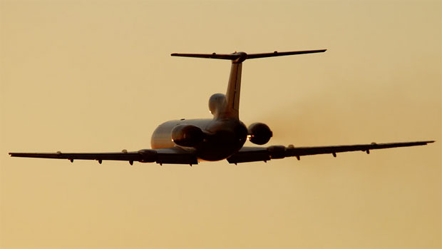 Polish Air Force Tu-154M flies into the sunset. Photo by Gordon Gebert Jr.