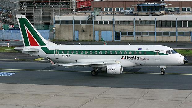 Alitalia Express Embraer E-170-100LR rolling along a Frankfurt taxiway