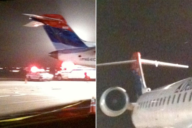 Delta Connection CRJ appears to have suffered damage to its vertical stabilizer and left horizontal stabilizer