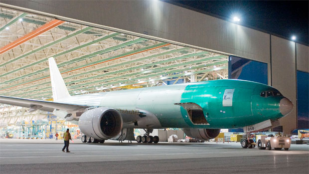 Workers rolled out the first Boeing 777 jetliner--a 777F destined for FedEx--at the seven-per-month rate in early May.
