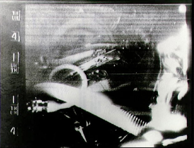 "Astronaut L. Gordon Cooper's face is visible in the background while his oxygen hose stands out clearly in this picture made from the broadcast of a live TV camera onboard ""Faith 7"" during the 17th orbit."