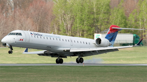 An Atlantic Southeast/Delta Connection Bombardier CRJ-700 N741EV sets down in Albany Photo by Mark Hsiung