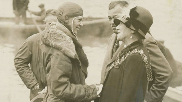 Amelia Earhart is greeted by the mayor of Southhampton, England on June 20, 1928