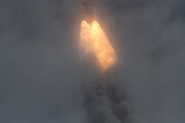 Atlantis ascends through the clouds