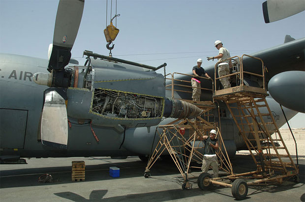U.S. Air Force members of the 746th Aircraft Maintenance Unit guide an Allison T56 turboprop engine into place as they remount it onto a Lockheed C-130H Hercules aircraft on 13 July 2007, in Southwest Asia.