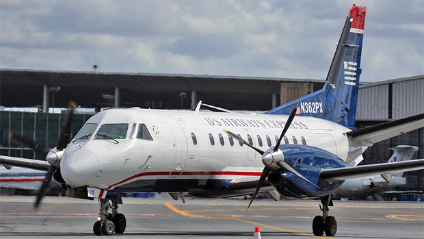 A Colgan Air Saab 340B N362PX operating for US Airways Express at LaGuardia Airport.