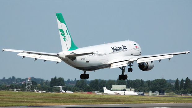 A Mahan Air Airbus A300 EP-MNT lands at Birmingham International Airport in England.