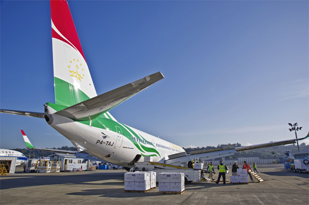 Over a ton of medical supplies are seen being loaded for the delivery flight to Tajikistan. (Photo by Boeing)