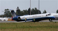 United Express/Trans States Airlines Embraer ERJ-145 (N840HK) in the grass in Ottawa