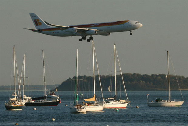 Photo of the Day: An Iberia Airbus A340-300 floats over some sailboats in the Harbor on final approach to Boston Logan International Airport