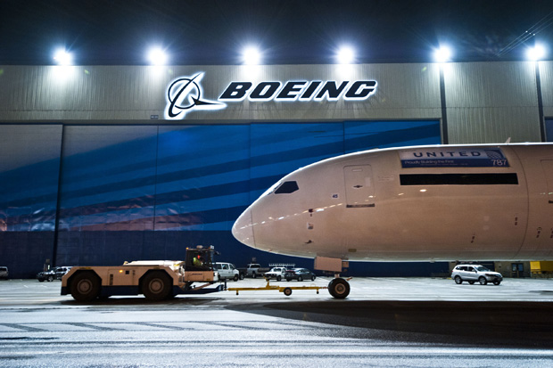 United's first 787 Dreamliner is towed past a Boeing sign