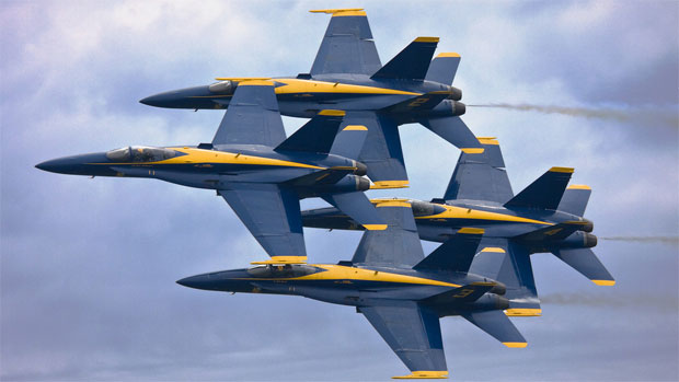 The US Navy Blue Angels flyby in tight formation