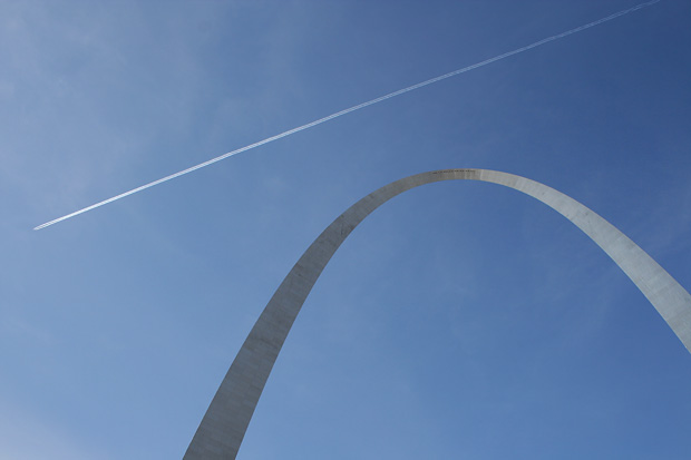 On a cold December morning, a twin-engine jet leaves a contrail high above the Gateway Arch in St. Louis.