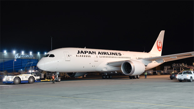 The first Boeing 787 Dreamliner to enter service for Japan Airlines (JAL) rolls out of the paint hangar