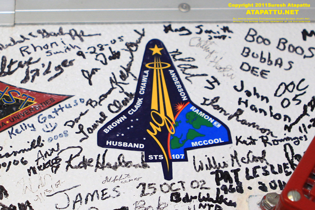 The signatures of the crew of STS-107 were placed here in October 2002 as the crew prepared for their upcoming mission. As part of the crew equipment fit test, they would have entered the shuttle Columbia through this white room. They were lost in the Columbia disaster.