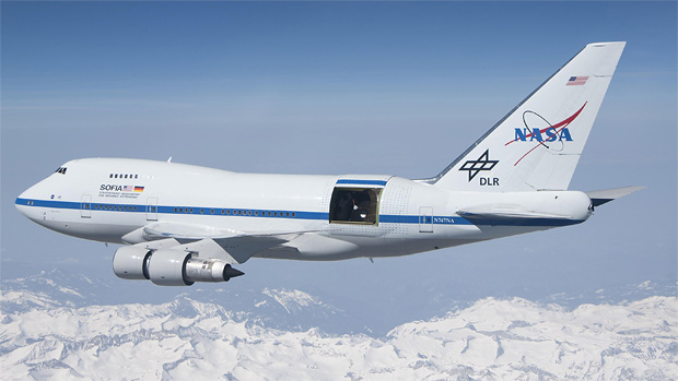 SOFIA observatory flying over the Sierra Mountains with open telescope door