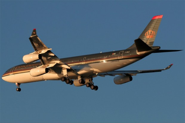 The sun sets on an arriving Royal Jordanian Airbus A340-200 F-OHLQ
